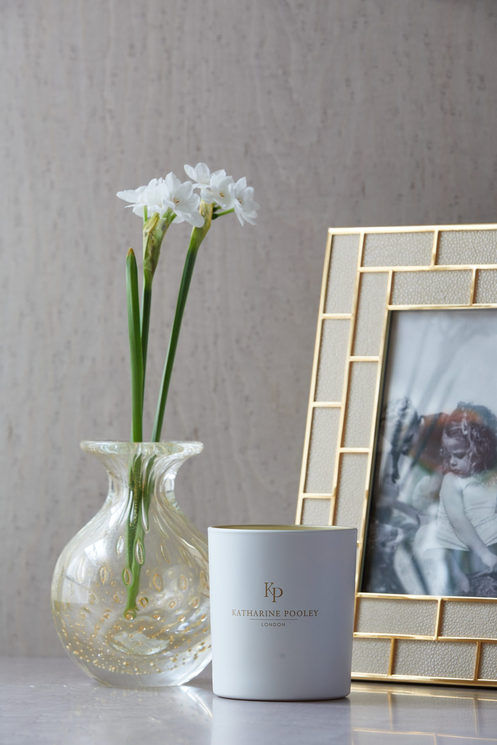 Picture frames are a beautiful part of any home. In this image Katharine Pooley blends her frames into a home setting.